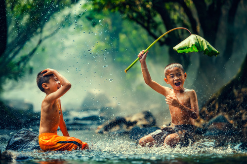 Children playing in the river with lotus leaves Stock Photo 01