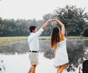 Couple dancing by the lake Stock Photo