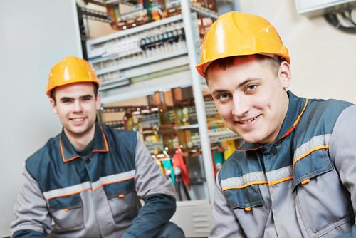 Electrician professional technician in uniform Stock Photo