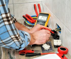 Electrician technician checks the line switch Stock Photo 01