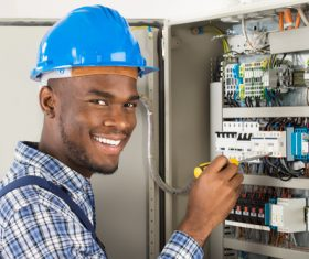 Electrician technician repairing the electric brake Stock Photo 01