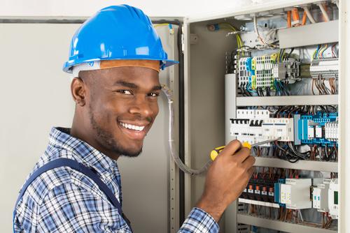 Electrician technician repairing the electric brake Stock Photo 01