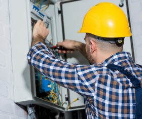 Electrician technician repairing the electric brake Stock Photo 02