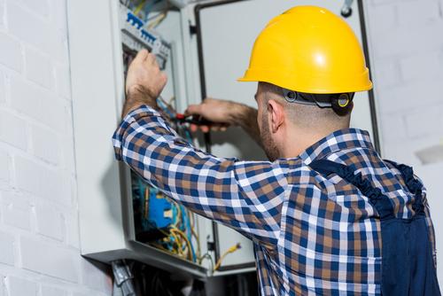 Electrician technician repairing the electric brake Stock Photo 02