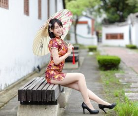 Exquisite ultra short cheongsam Asian woman Stock Photo