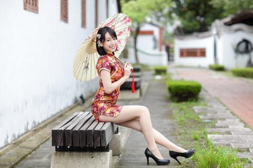 Exquisite ultra short cheongsam Asian woman Stock Photo