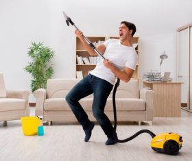 Funny man holding vacuum cleaner Stock Photo 01