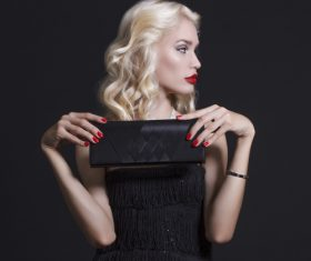 Holding black handbag Luxury young woman Stock Photo 02