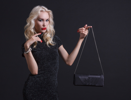 Holding black handbag Luxury young woman Stock Photo 01