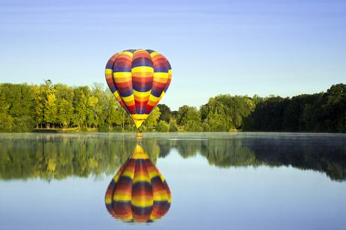 Hot air balloon water reflection Stock Photo