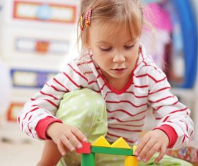 Little girl playing with blocks Stock Photo
