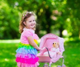 Little girl pushing a buggy Stock Photo