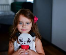 Little girl with panda toy Stock Photo