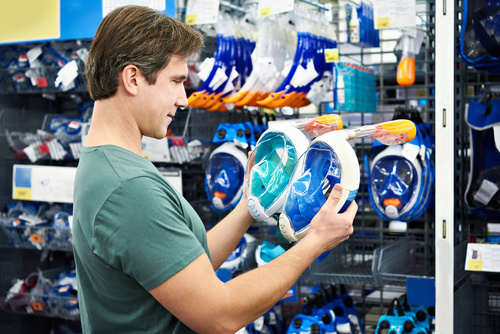 Man buys sporting goods Stock Photo