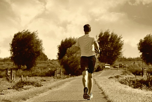 Man jogging outdoors Stock Photo