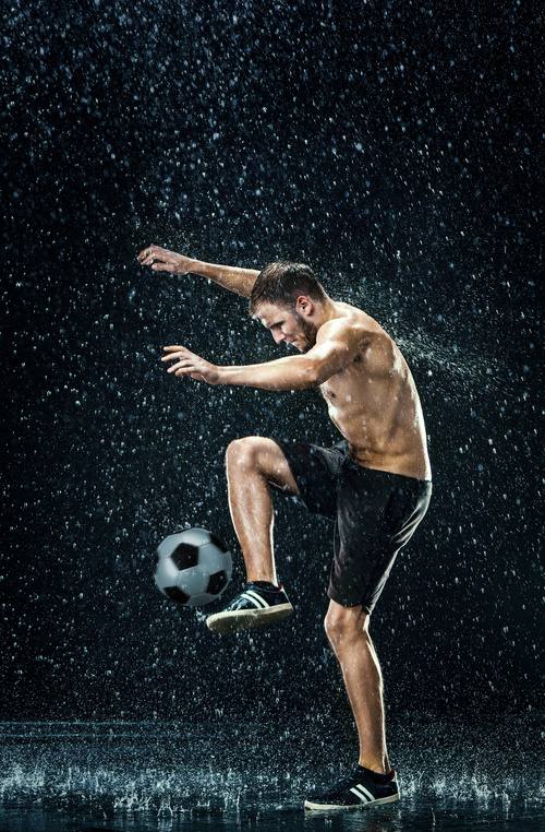 Man juggle in the rain Stock Photo 01