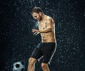 Man juggle in the rain Stock Photo 02