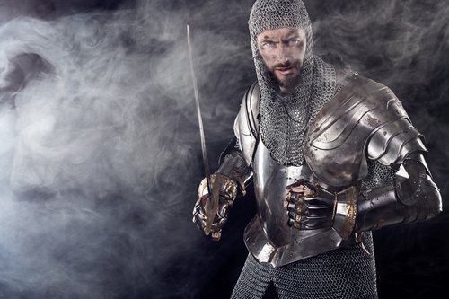Medieval knight wearing armor Stock Photo 04