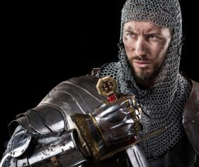 Medieval knight wearing armor Stock Photo 08