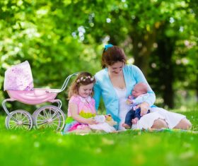 Mother with children in the park Stock Photo 01