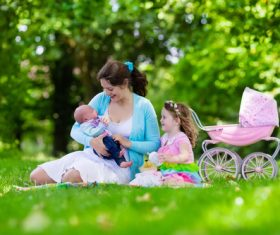 Mother with children in the park Stock Photo 02