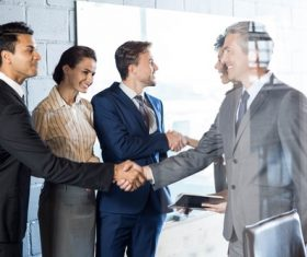 Negotiate a successful handshake Stock Photo 01