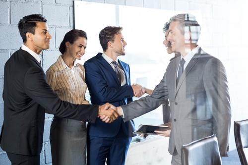 Negotiate a successful handshake Stock Photo 01