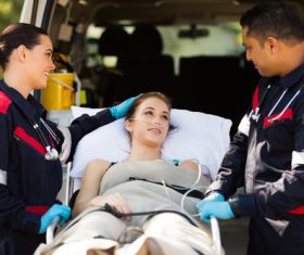 Paramedics rescuers comforting patients Stock Photo