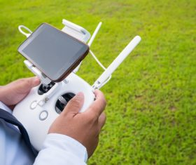 Person holding Quadrocopter wireless controller Stock Photo