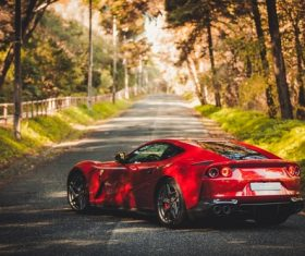 Red Ferraricar cars parked on the road Stock Photo