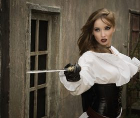 Role player Female pirate wielding a sword Stock Photo 02