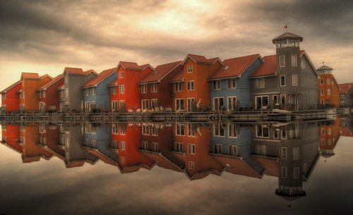 Sea houses reflected in sea Stock Photo