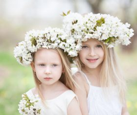 Sisters with white garlands Stock Photo