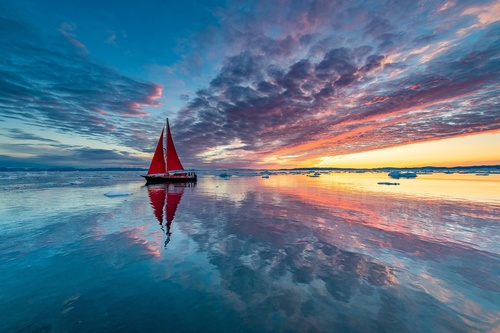 Sky clouds sunlight boat reflection in sea water Stock Photo