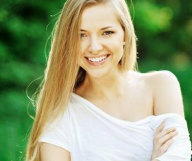 Smiling woman wearing white T-shirt Stock Photo