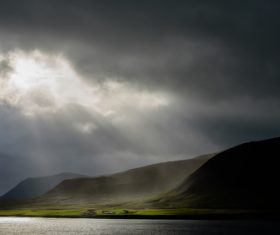 Sunlight through the dark clouds natural scenery Stock Photo