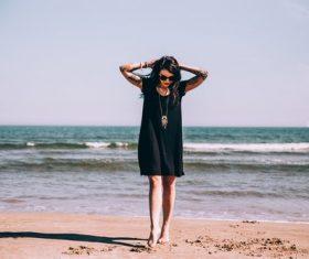 Tattoo woman on summer travel beach Stock Photo