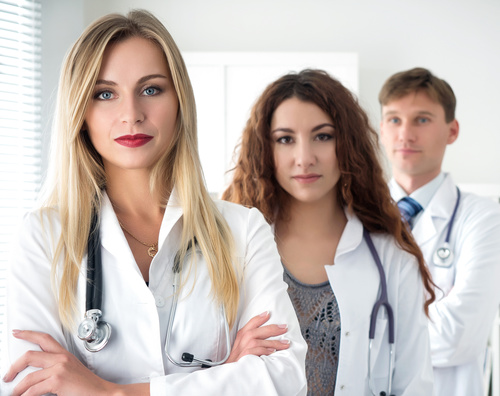 Three doctors taking a group photo Stock Photo