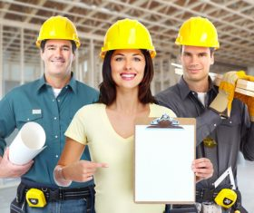 Three house renovation workers Stock Photo