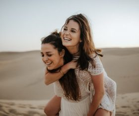 Two happy women in the desert Stock Photo