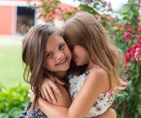 Two hugging little girls Stock Photo