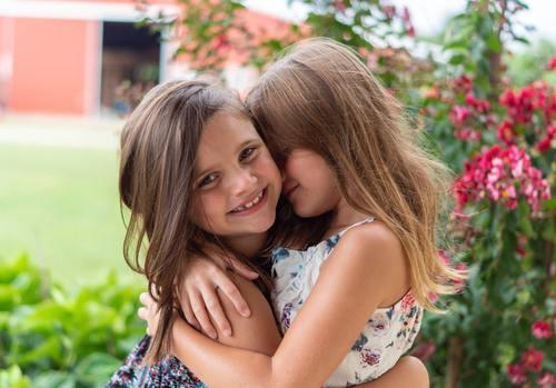 Two hugging little girls Stock Photo