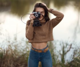 Wear high waisted jeans female photographer Stock Photo 02