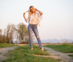 Wear torn jeans women standing outdoor Stock Photo