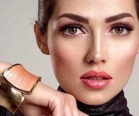 Wearing bracelets makeup women Stock Photo