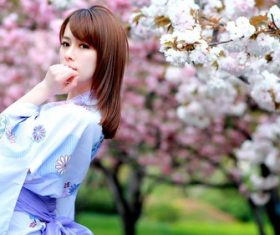Wearing kimono woman watching cherry blossoms Stock Photo