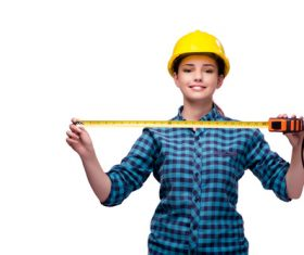 Wearing overalls woman holding meter ruler Stock Photo