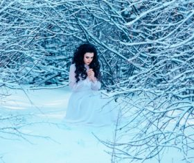 Winter outdoor woman wearing white dress Stock Photo