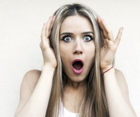 Woman frightened expression Stock Photo