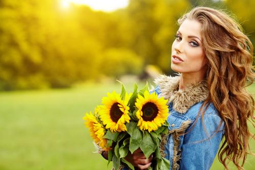 Woman holding sunflower flower Stock Photo